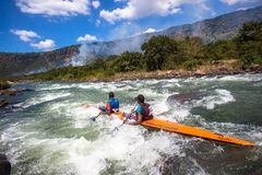 River Rapids Canoe Team. Doubles team Mbandwa and Zondi in the fast river rapids with there canoe at mid day the Non Stop Dusi canoe marathon. Photo image Royalty Free Stock Photography