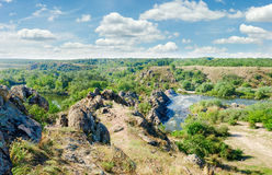 River with rapids and a rock outcrops on its banks Royalty Free Stock Photo