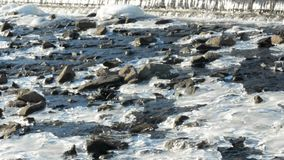 River rapids with rocks and icy patches stock video