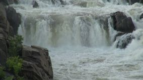 River rapids waterfall over rocks stock video