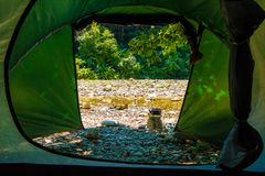 River and ravine seen from tent. View of river in rocky ravine seen from tent of tourist camp in sunny summer day Royalty Free Stock Image