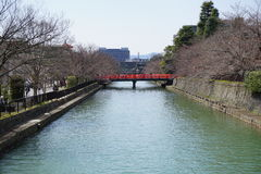 River and red bridge, Kyoto, Japan Royalty Free Stock Image