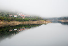 River and reflected village Royalty Free Stock Photo