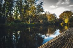 River Reflection Of Autumn Landscape on a Medieval Aqueduct in Scotland royalty free stock images