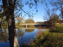 River with reflection by a Bridge. This is a beautiful river here in Wisconsin with a reflection by a bridge out in the country Royalty Free Stock Photo