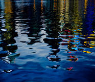 River reflection of a city. A river refloection taken during dusk of a asia city stock photos