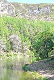 river with reflection in Elan Valley in Wales, UK Royalty Free Stock Images