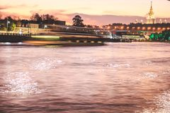 River with a reflection of the lights of the night city. stock photography