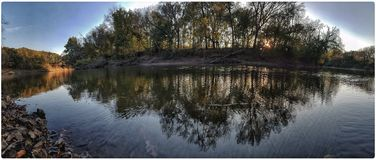 River reflection. Walnut river at sunset Stock Photography