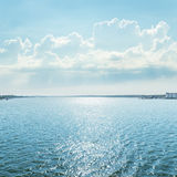 River with reflections under blue sky with clouds Stock Photography