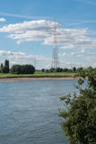 River rhine with blue sky and clouds, power lines and power plan Royalty Free Stock Photo