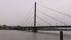 River Rhine at Dusseldorf Germany, Theodor-Heuss bridge with a view of the skyline stock photo