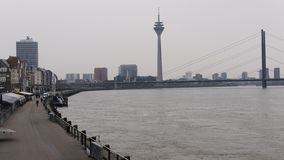 River Rhine at Dusseldorf Germany,view to the shore promenade, in the background Oberkasseler bridge and Tower. River Rhine at Dusseldorf Germany, view to the royalty free stock photo
