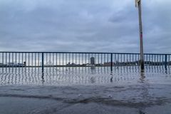 The river Rhine is flooding the promenade. With handrail royalty free stock photography