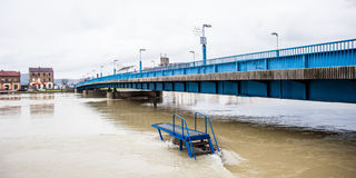 River rises to the dangerous level. Display of swollen river threatening the city and its people. Dangerous level of water Royalty Free Stock Photography