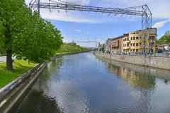 Somes river and river bank with houses from Cluj-Napoca.. Royalty Free Stock Photos