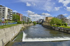 Somes river and river banks crossing Cluj-Napoca city. Stock Image
