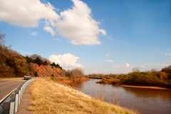 River Road. Scene where Oklahoma State Highway 71 winds along the Cimarron River Stock Photos