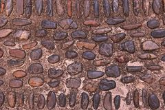 River Rock pebbles background on floor. The idea for decoration Royalty Free Stock Photo