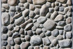 River Rock Wall. A wall constructed from river rock stock photos