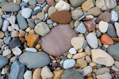 River Rocks. Colorful smooth river rocks on the shoreline royalty free stock photos