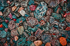 River Rocks. Colorful river rocks sprinkled with rain stock photography