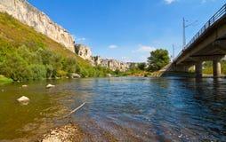 River Rocks. Iskar River, Bulgaria and the bridge the train line Royalty Free Stock Photography