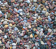 River Rocks. Small river rocks on flat surface royalty free stock image