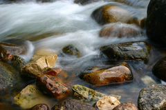 River And Rocks. Long exposure of Popo Agie river cascading over rocks, Sinks and Rise State Park, Wyoming royalty free stock photography