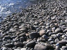 River Rocks. Rounded rocks alongside a river Stock Photo