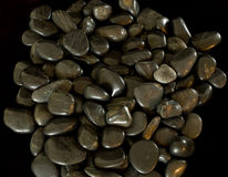 River rocks against black Royalty Free Stock Image