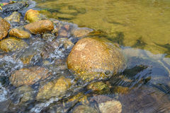 River rocks background Stock Photography