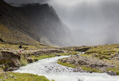 River, rocks and clouds in Collanes Valley in El Altar volcano Stock Photography