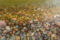 River Rocks. Colorful rocks in a river in Glacier National Park, Montana Royalty Free Stock Image