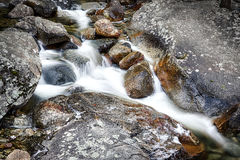 River rocks and flowing water Royalty Free Stock Images