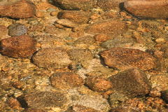 River Rocks. Huge river rocks in a clean wide fast flowing river in the New Hampshire mountains Stock Photo