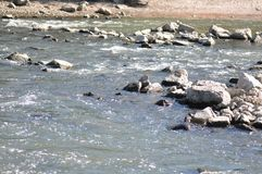 River with rocks. In a summer day royalty free stock image