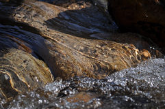 River rocks. River running over smooth rocks in the river stock photos