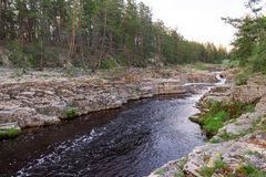 The river among the rocks. Swift river among the rocks royalty free stock photos