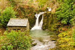 River Rothay falls. Waterfalls and the grotto on the river Rothay at Rydal, Cumbria Royalty Free Stock Images