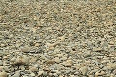 River round stones background Stock Photos