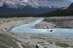 A river running through an alluvial plain Stock Photos