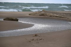 River Running into Lake Michigan Stock Photo