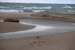 River Running into Lake Michigan Stock Photo