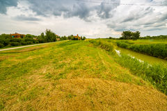 River running near eighteenth century church in bucolic landscap. E of the countryside of Romagna in Italy Stock Photos