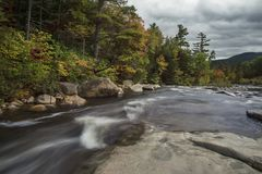 River running among stony shores in the forest. Franconia Notch State Park. USA. New Hampshire. stock photo