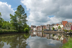 River running though dutch village. Scene of the ancient dutch village Maarssen with characteristic houses.River Vecht running thru the village. Landscape format Royalty Free Stock Image