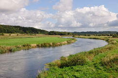 River running through a valley Stock Image