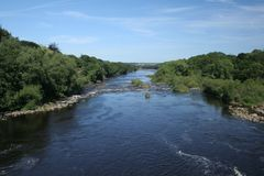 River runs. River Tyne runs through some of the most beautiful scenery in the Tyne valley and ends up in the North Sea Stock Images