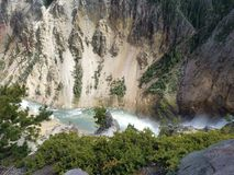 A river runs through the canyon. The lower grand canyon of yellowstone national park river Royalty Free Stock Images